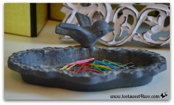 Cast iron bird feeder with paper clips - 42 Things in Your Home Office and Library