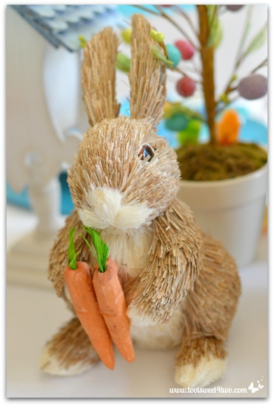 Straw Bunny Holding Carrots Decorating The Table For An Easter Celebration