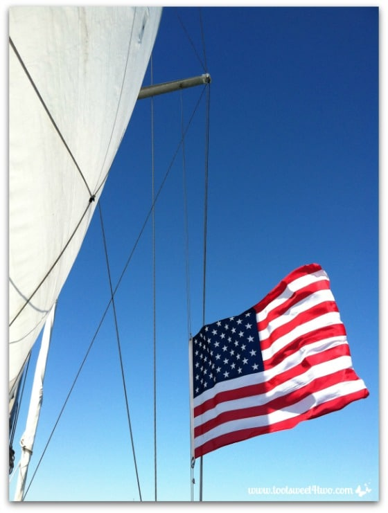 Love Leaves a Memory - flag at half mast on the sailboat