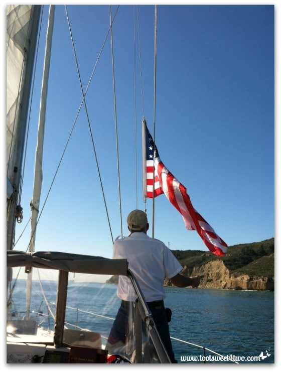 Love Leaves a Memory - the boat's captain raising the flag