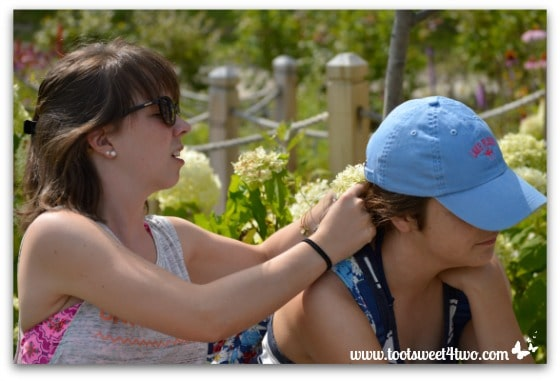 Erin putting a flower in Molly's hair at Chautauqua Institution