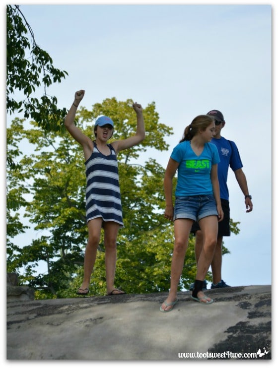 Molly, Bizzy, Ryan on top of hill at Chautauqua Institution