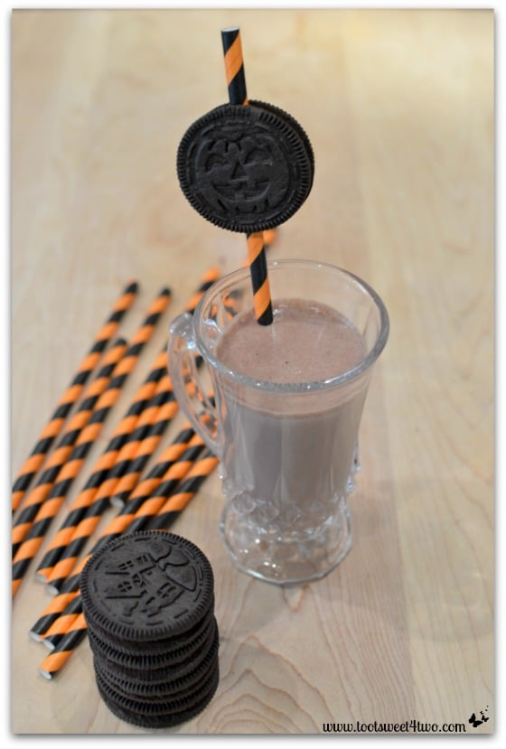 Chocolate milk and Oreo Halloween Cookie Straw - Cryptically Easy Chocolate Milk
