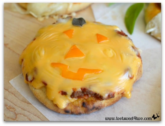 Jack-O-Lantern Pizza baked - Fright Night Mini Pizzas