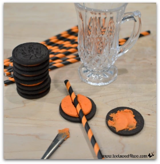 Placing the straw in the Oreo - Cryptically Easy Chocolate Milk