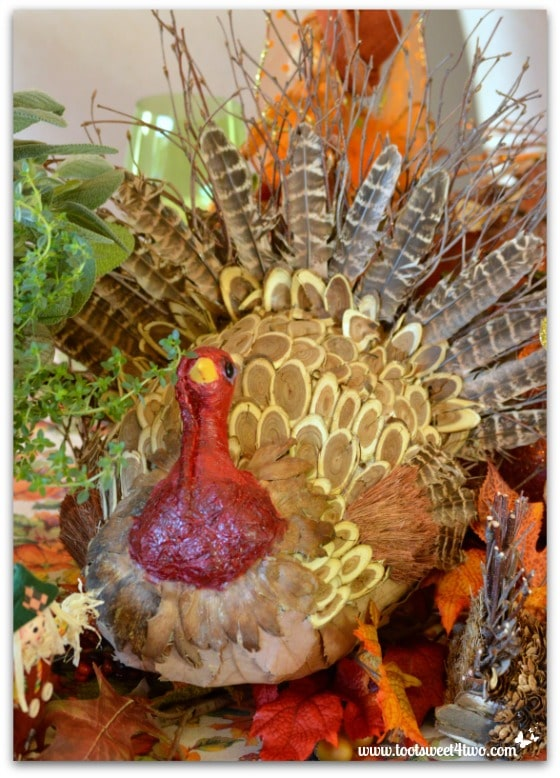 Decorative turkey made from twigs, feathers, leaves and wood