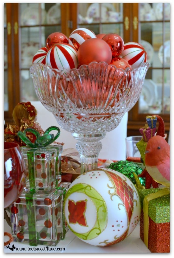 Crystal bowl with red Christmas ornaments