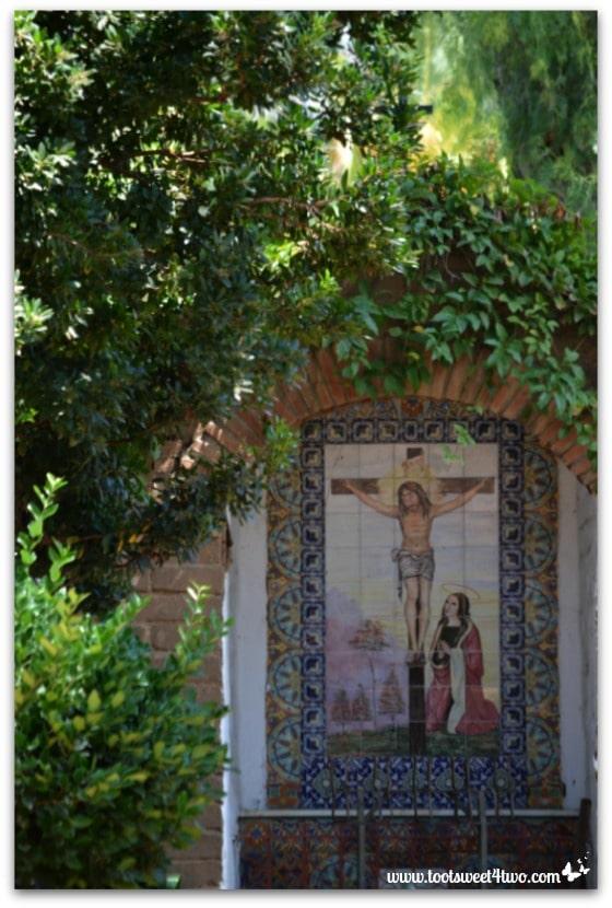 Tile mural of Jesus on the cross in Mission San Antonio de Pala gardens
