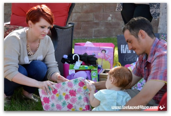 Opening gifts with Mom and Dad - Baby Turns One