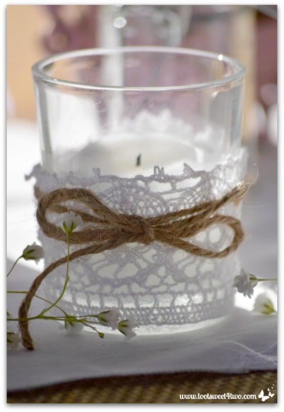 Votive candle with lace and twine