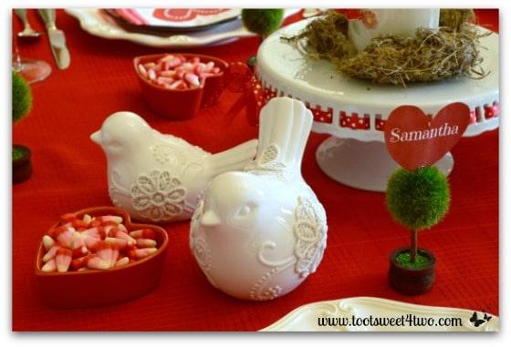 White ceramic birds on Valentine's Day table