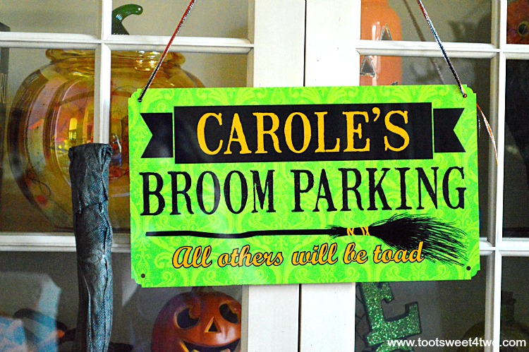 Close-up of Carole's Broom Parking sign
