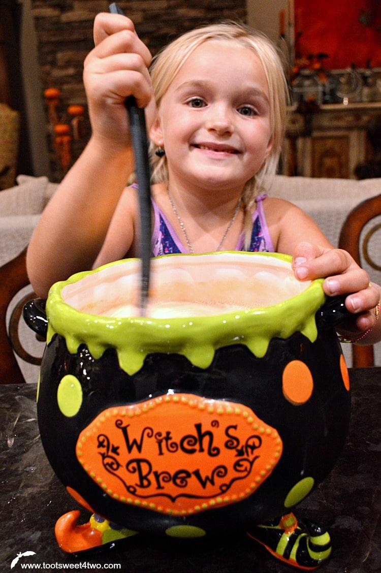 Happy Princess Sweetie Pie stirring the punch
