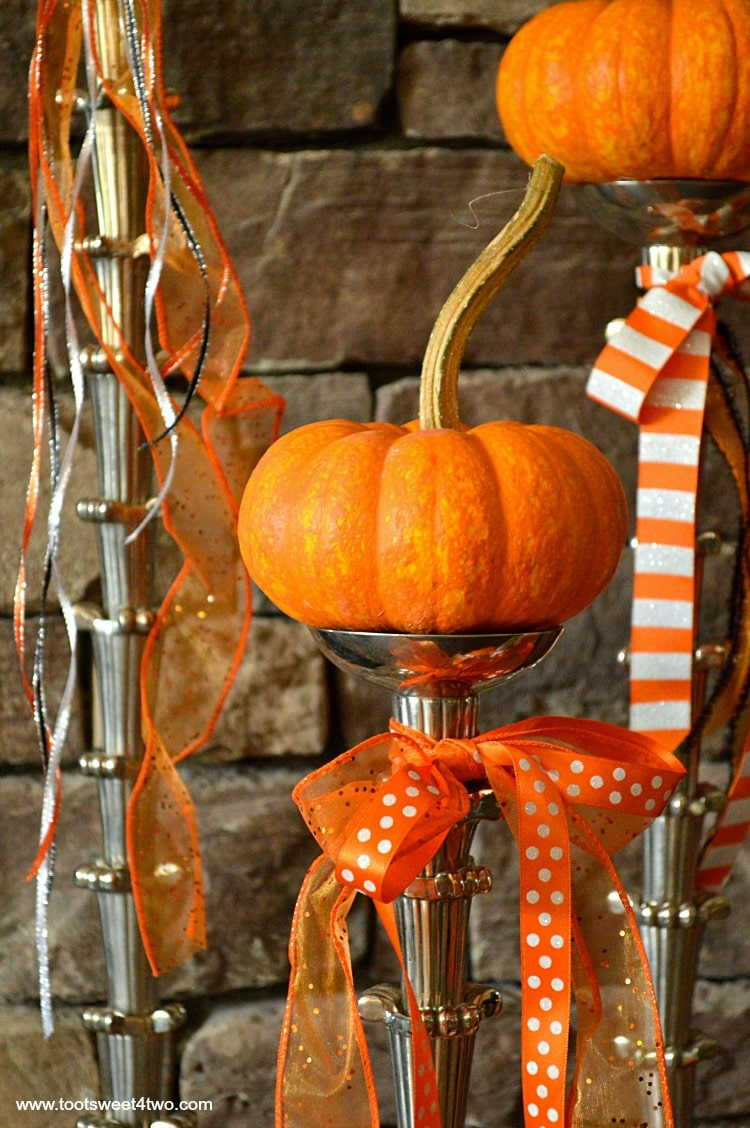 Jack-Be-Little pumpkins on tall candlesticks
