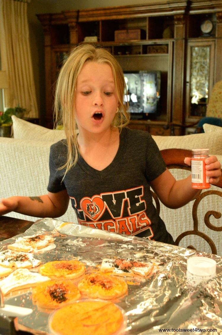 Princess P decorating Halloween cookies