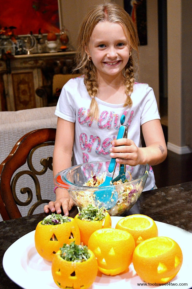 Princess P smiling and making Easy Jack-O-Lantern Salad Cups