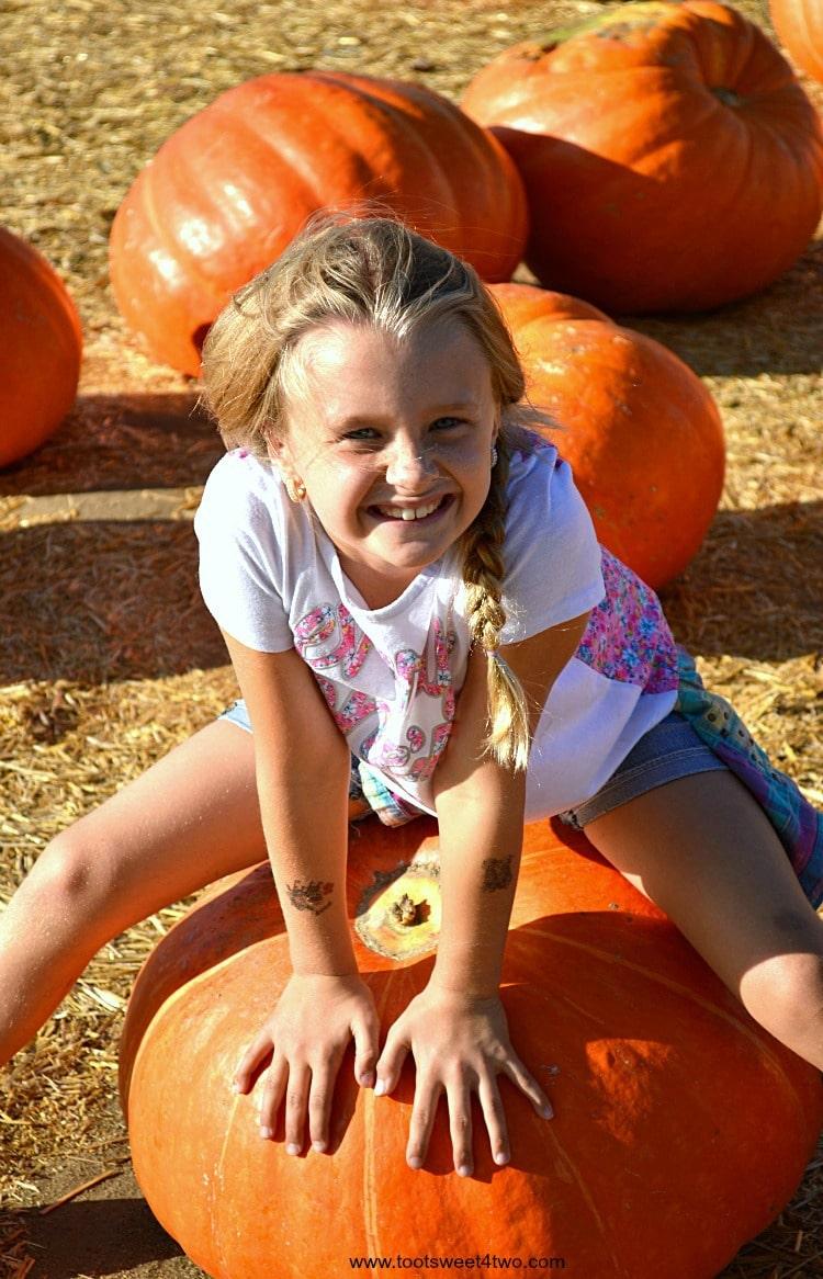 Princess P straddling a Big Mac pumpkin 2015