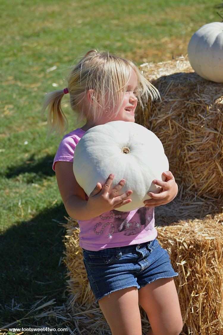 Princess Sweetie Pie carrying a white pumpkin