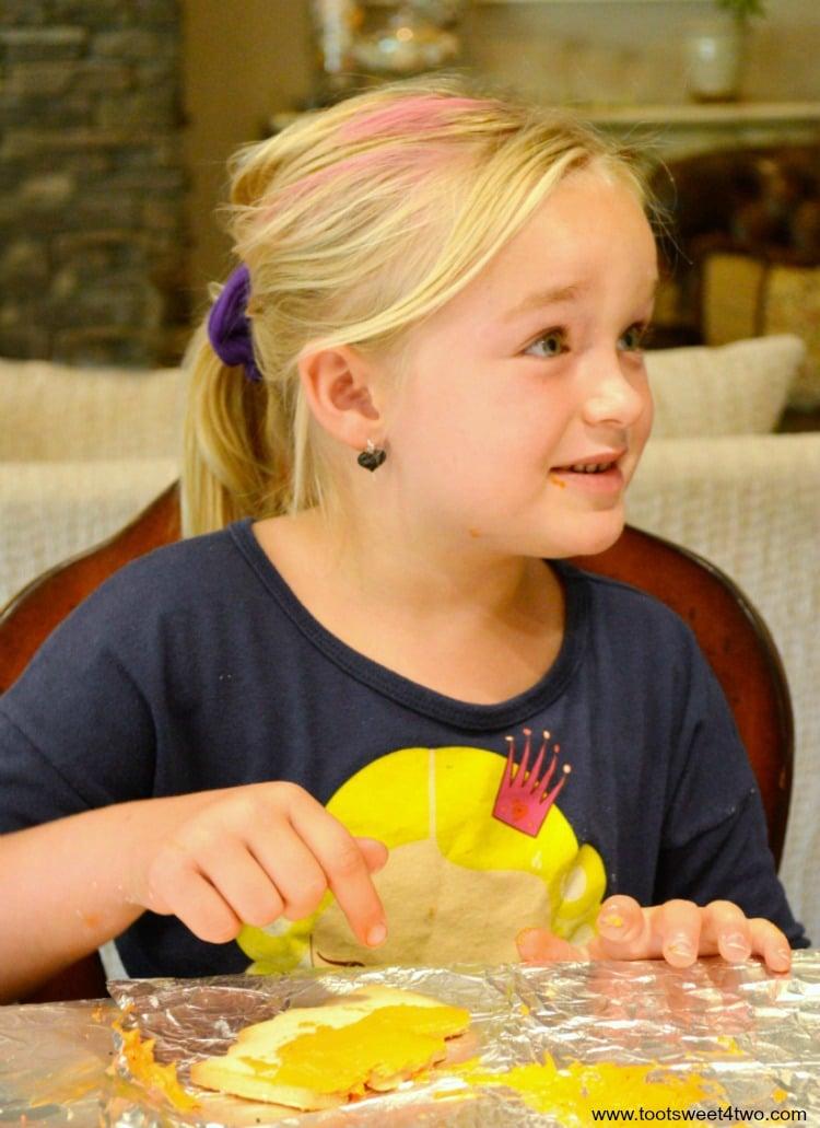 Princess Sweetie Pie decorating Halloween cookies