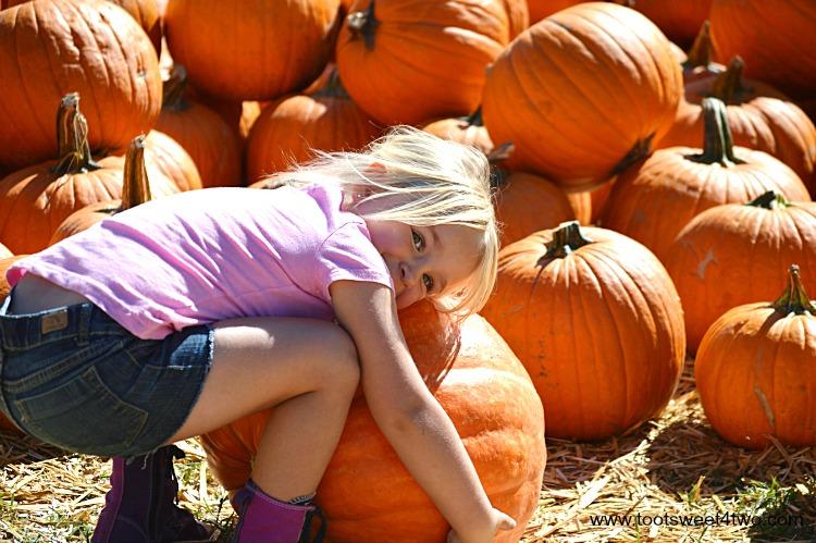 Princess Sweetie Pie hugging a pumpkin