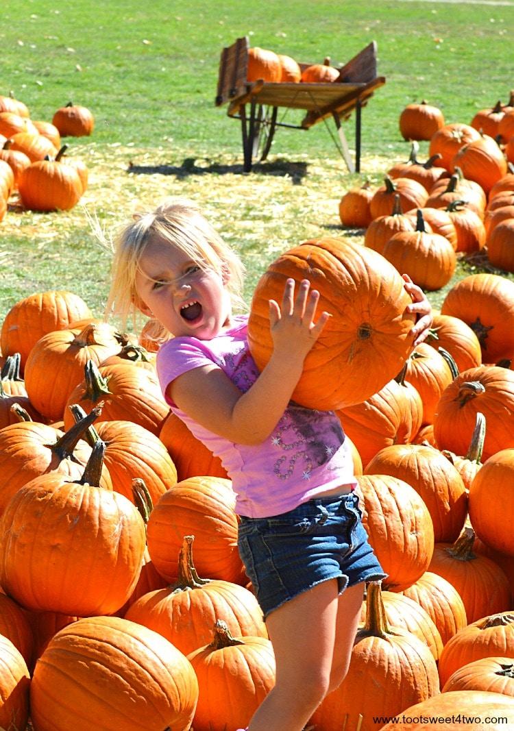 Princess Sweetie Pie power lifting a pumpkin
