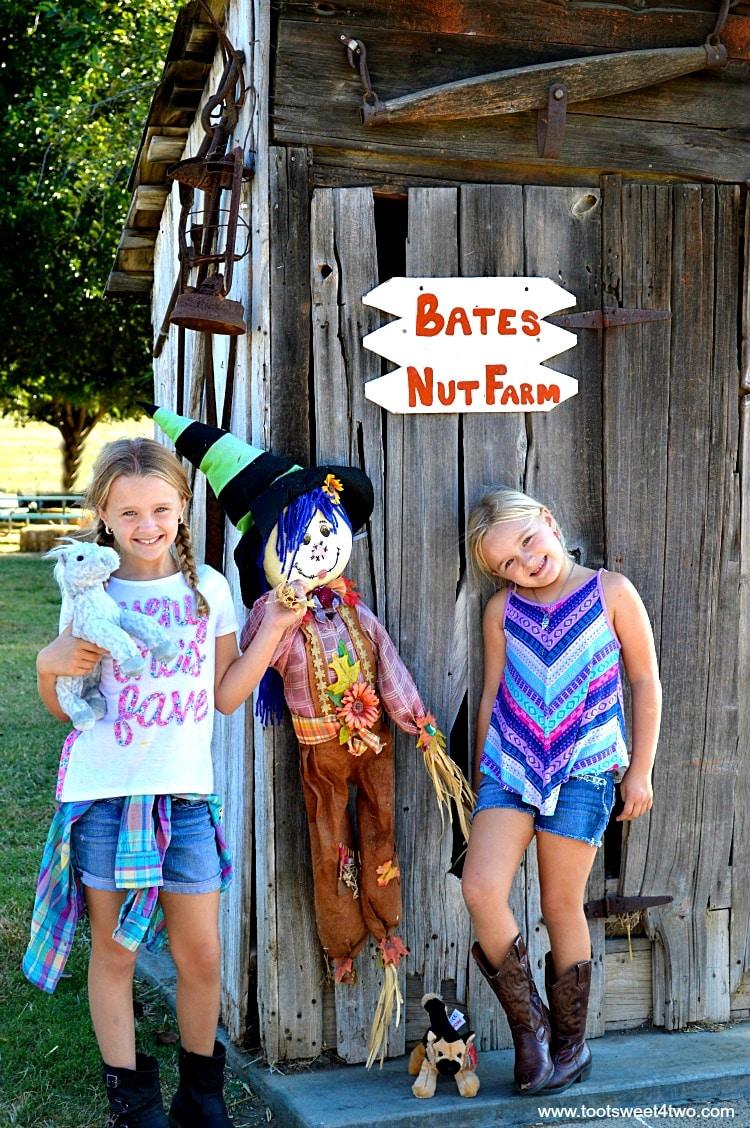 Princesses P posing with scarecrow 2015