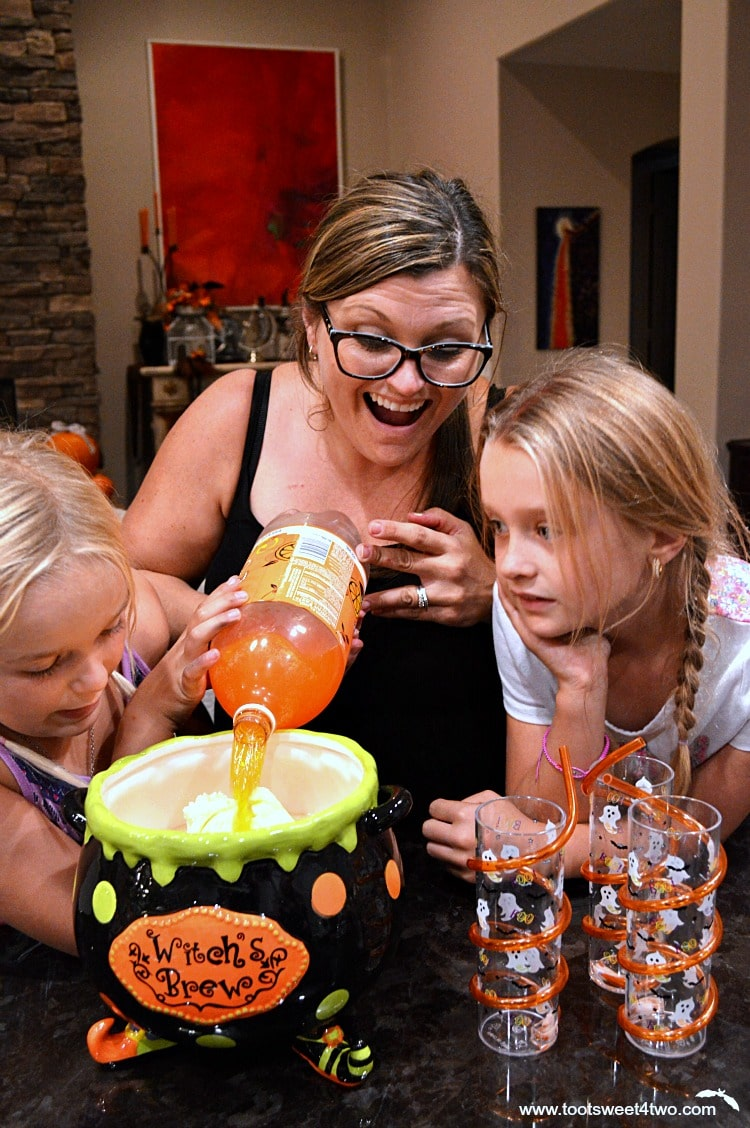 The Princesses and Tiffany pouring orange soda for punch