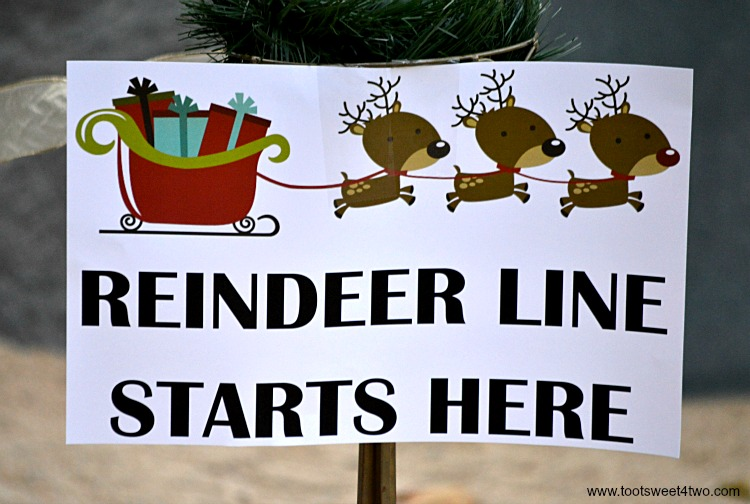 Reindeer Line Starts Here sign