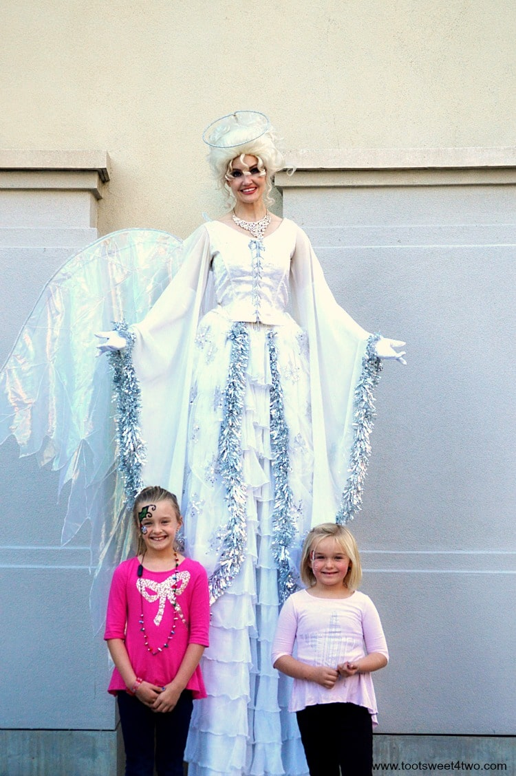 Angel stilt-walker posing with Princess P and Princess Sweetie Pie