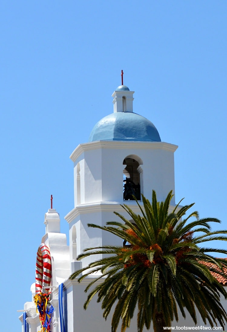 Bell tower Mission San Luis Rey decorated for festival