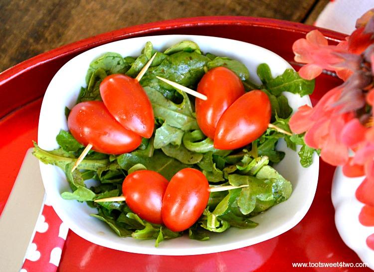 Grape tomatoes cut like hearts for Sweetheart Ham and Egg Breakfast