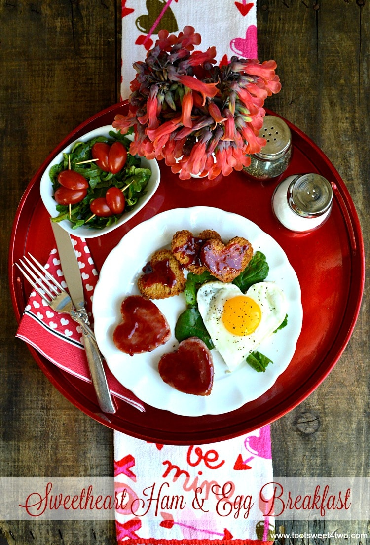 Sweetheart Ham and Egg Breakfast - all the dishes (fried eggs, ham, toast and a grape tomato salad) to make this Valentine's Day breakfast are cut in the shape of different size hearts! A special breakfast recipe to show your loved one how much you care. | www.tootsweet4two.com