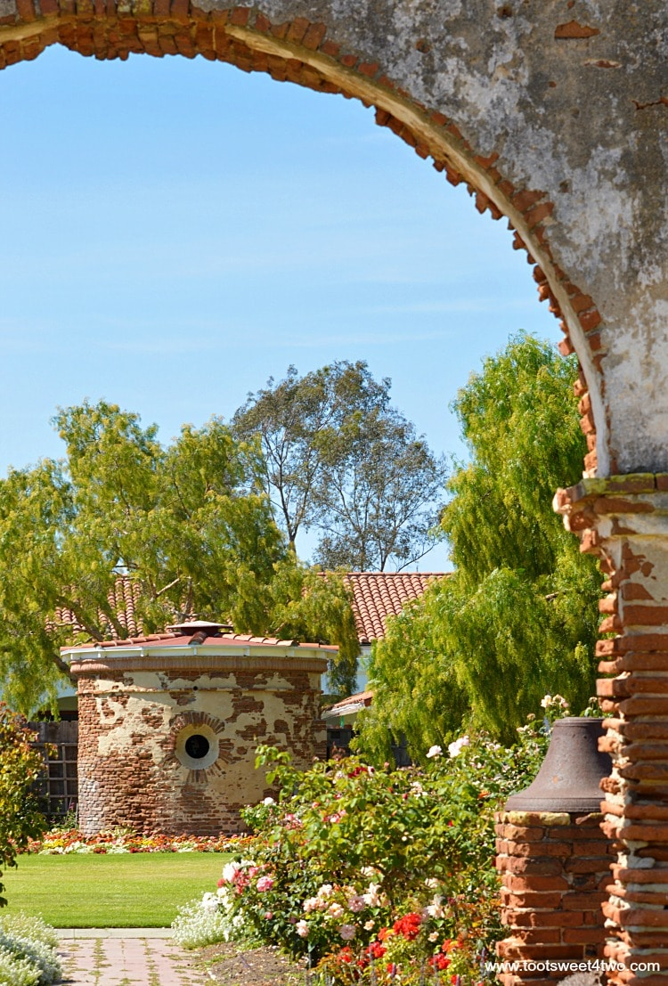 View from other side of the Carriage Arch ruin at Mission San Luis Rey Welcome Center