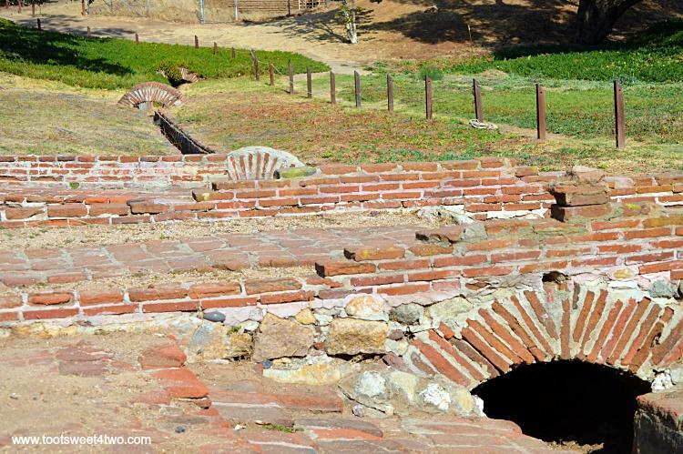 Irrigation channels winding through landscape at Mission San Luis Rey Lavanderia