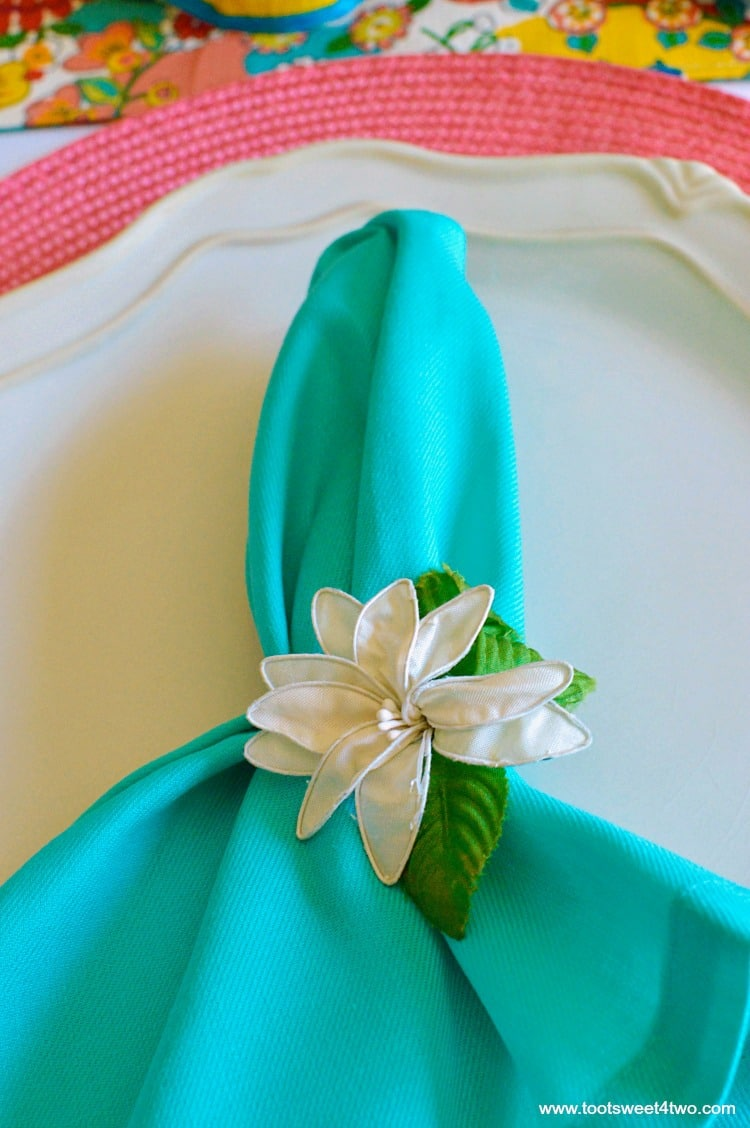 Aqua napkin and peach placemat for Decorating the Table for a Cinco de Mayo Celebration
