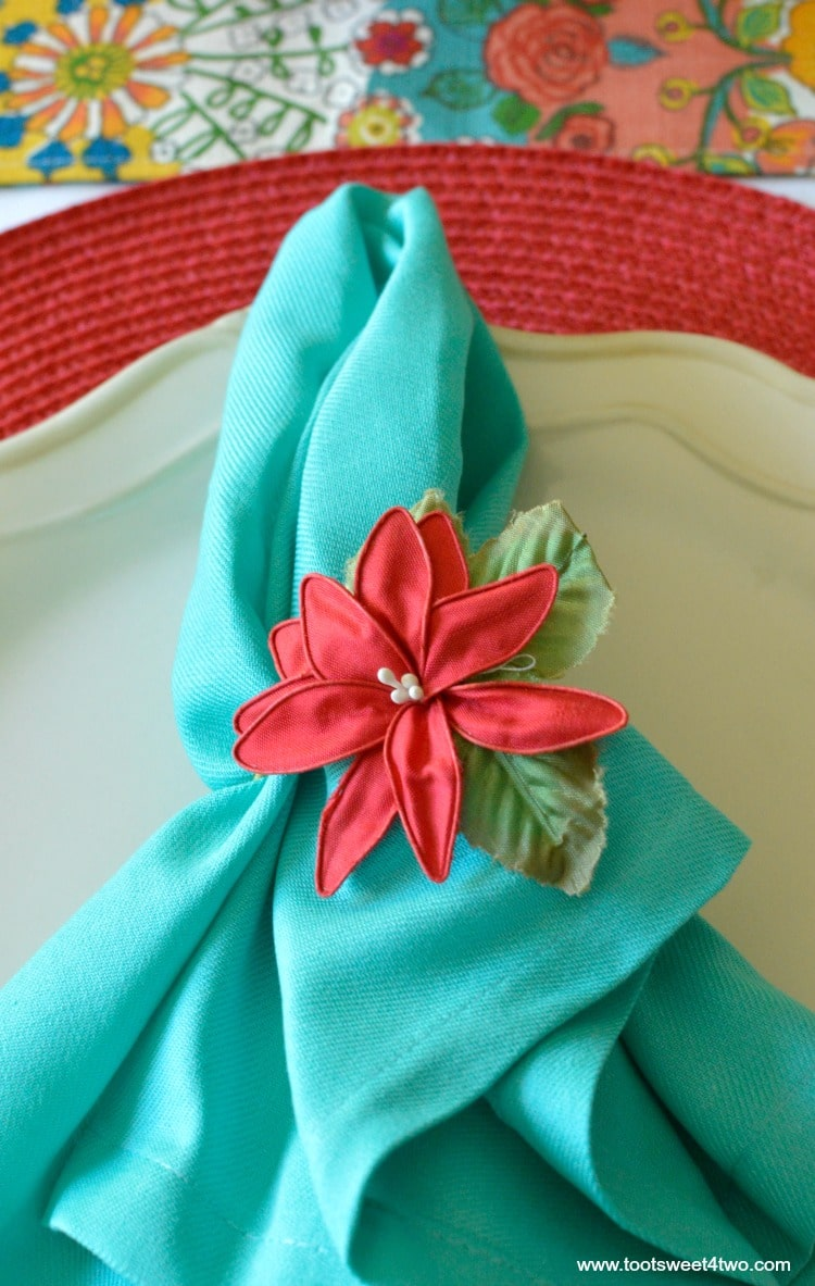 Aqua napkin and red placement for Decorating the Table for a Cinco de Mayo Celebration