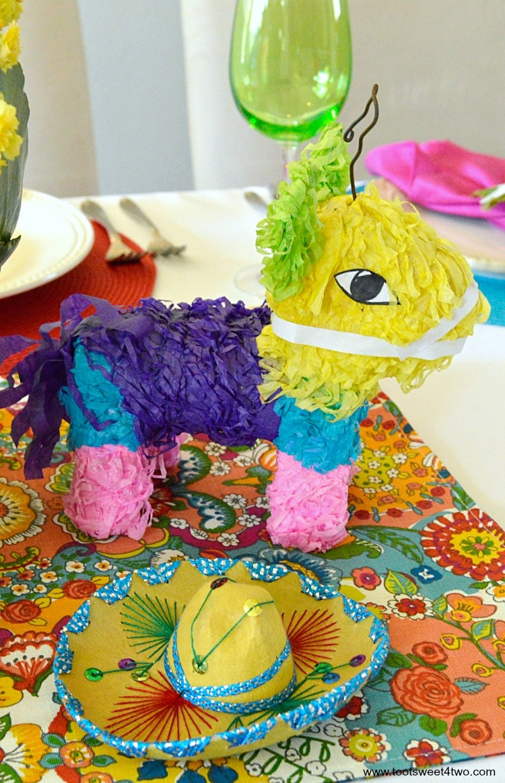 Mini Donkey Pinata and Yellow Mariachi Sombrero for Decorating the Table for a Cinco de Mayo Celebration