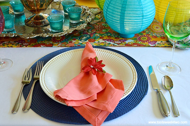 Peach Napkin and Dark Blue Placement for Decorating the Table for a Cinco de Mayo Celebration