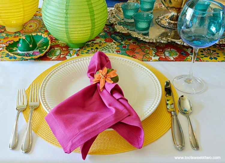 Pink Napkins and Yellow Placemat for Decorating the Table for a Cinco de Mayo Celebration