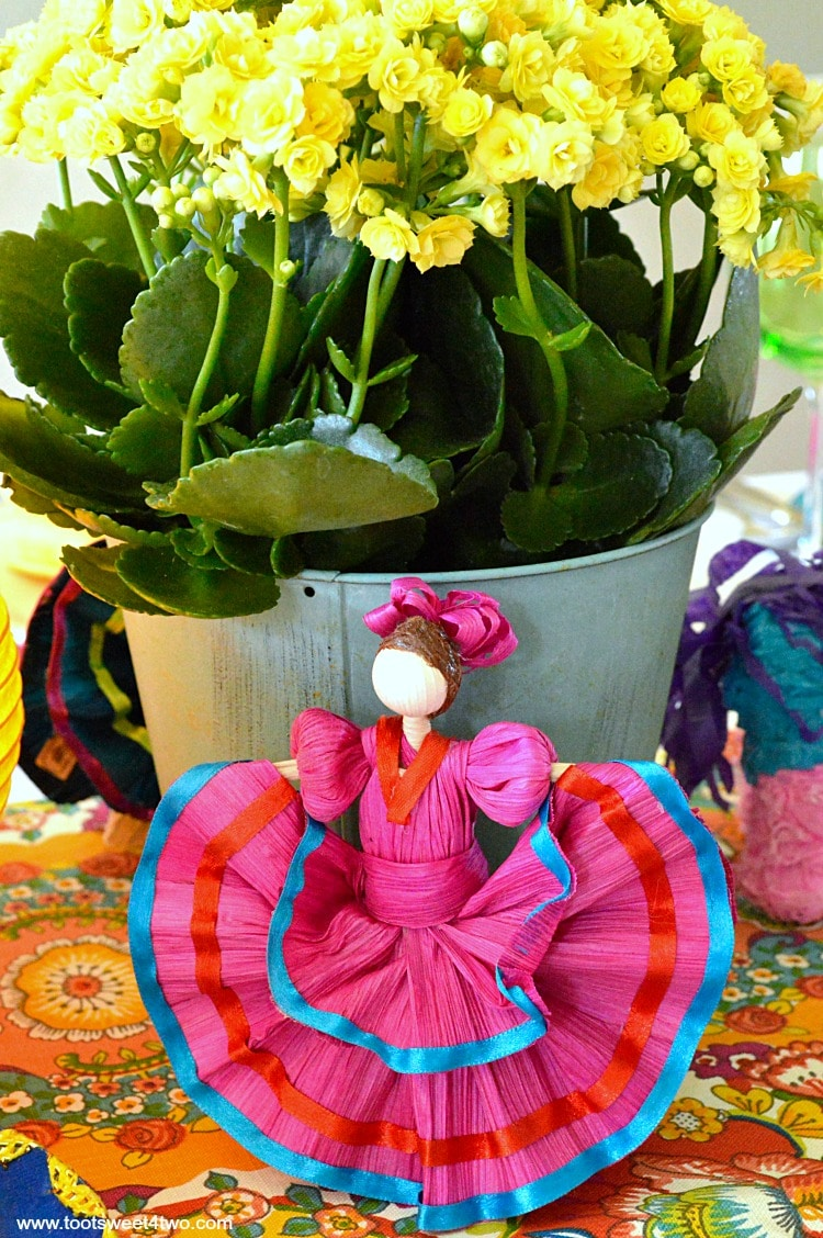 Pink corn husk doll for Decorating the Table for a Cinco de Mayo Celebration