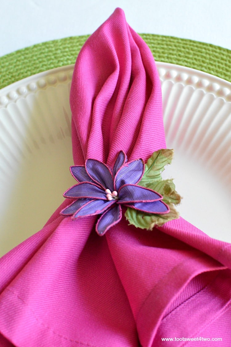 Pink napkin with green placemat for Decorating the Table for a Cinco de Mayo Celebration