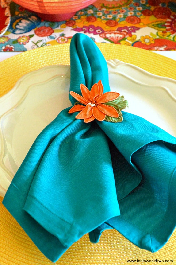 Turquoise napkin and yellow placement for Decorating the Table for a Cinco de Mayo Celebration