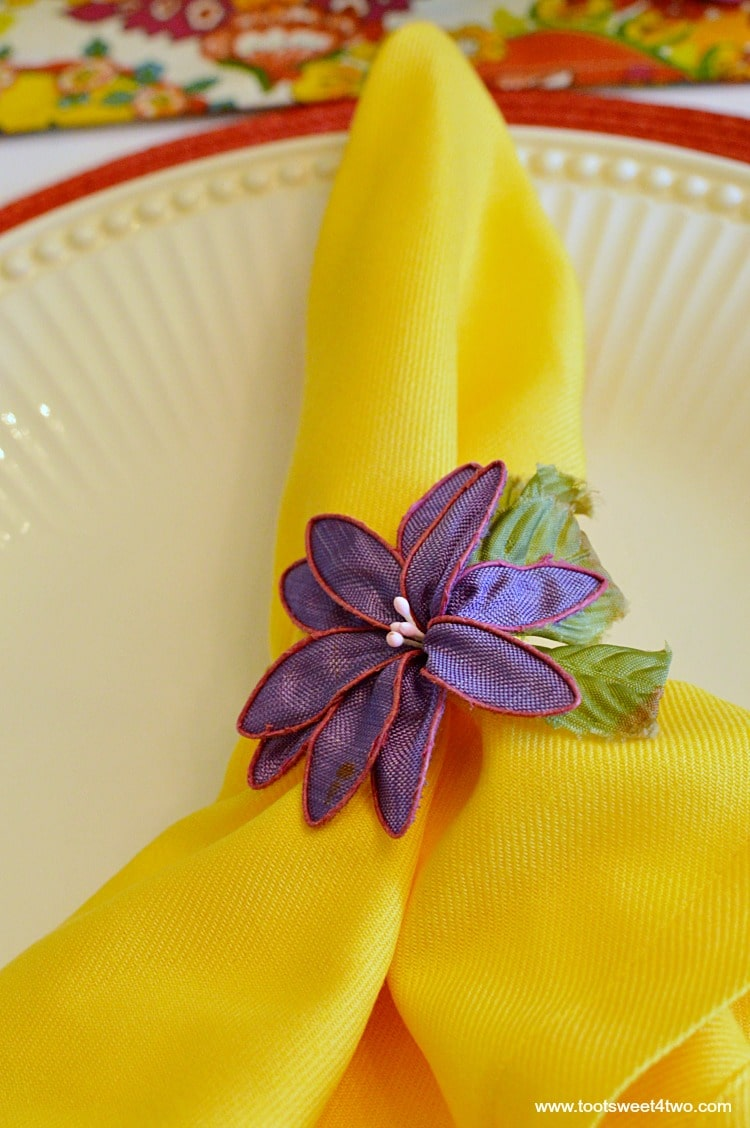 Yellow napkin with purple napkin ring for Decorating the Table for a Cinco de Mayo Celebration
