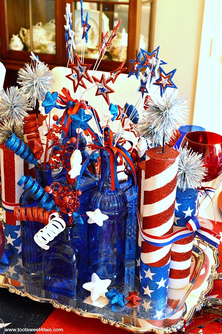 Decorating The Table For A 4th Of July Party Decked Out In Red White