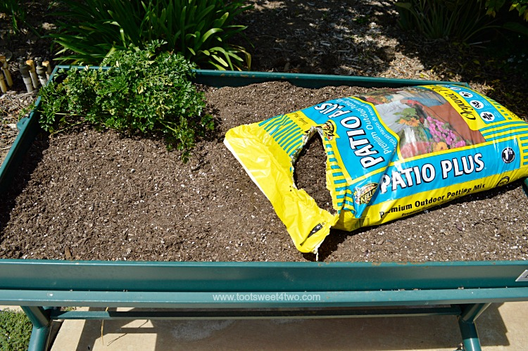 Adding Potting Soil to the L Garden Elevated Rolling Trough Planter