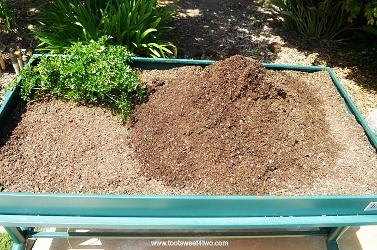 Potting Soil in L Garden Elevated Rolling Trough Planter